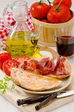 Spanish Cuisine. Tomato bread and Serrano Ham. Pa amb tomaquet i Stock Photos