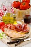 Spanish Cuisine. Tomato bread and Serrano Ham. Pa amb tomaquet i Stock Photos