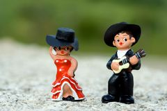 Spanish dancer. Guitarist and a Spanish dancer doll Stock Photography