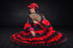 Spanish dancer hiding her face by fan Stock Images