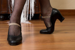 Spanish Dancer Shoes. Feet and shoes of a spanish dancer on a wooden floor royalty free stock photo