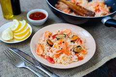Spanish dish paella with seafood, shrimps in pan Stock Photo