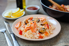 Spanish dish paella with seafood, shrimps in pan. Spanish dish paella with seafood, shrimps in traditional pan Stock Photos