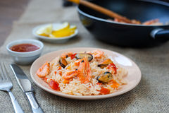 Spanish dish paella with seafood, shrimps in pan. Spanish dish paella with seafood, shrimps in traditional pan Royalty Free Stock Photo