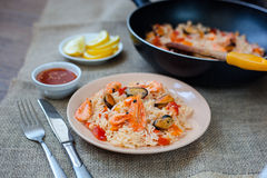 Spanish dish paella with seafood, shrimps in pan. Spanish dish paella with seafood, shrimps in traditional pan Stock Photo