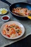 Spanish dish paella with seafood, shrimps in pan. Spanish dish paella with seafood, shrimps in traditional pan Stock Image