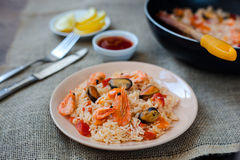 Spanish dish paella with seafood, shrimps in pan. Spanish dish paella with seafood, shrimps in traditional pan Royalty Free Stock Image