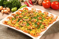 Spanish dish paella with seafood, shrimps, squid, rice, saffron,. Traditional tasty dinner Stock Photography
