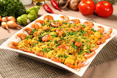 Spanish dish paella with seafood, shrimps, squid, rice, saffron, Stock Images