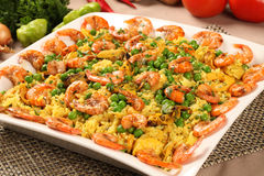 Spanish dish paella with seafood, shrimps, squid, rice, saffron,. Traditional tasty dinner Stock Images