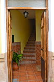Spanish doorway staircase Ronda Spain. Open front door leading to a staircase on a quiet street in Ronda Spain Stock Images