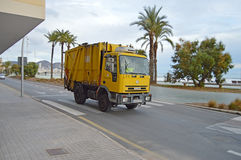 A Spanish Dustcart - Yellow Dustbin Lorry Refuge Collection Royalty Free Stock Photography