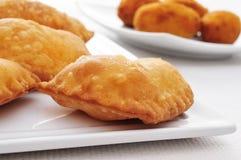 Spanish empanadillas, small meat or tuna pies Stock Photos