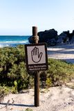 Spanish English Sign Restricted Area at Beach Stock Image