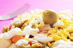 Spanish ensaladilla rusa. Closeup of a plate with a typical spanish ensaladilla rusa, russian salad Royalty Free Stock Photos