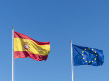 Spanish and European flag waving in the wind. Royalty Free Stock Photo