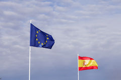 Spanish and European flags waving in the wind Royalty Free Stock Photo