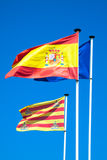 Spanish and European flags waving in the wind Stock Photos