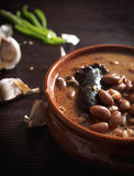 Spanish fabada with Black pudding in an earthenware dish on rust Stock Photo
