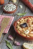 Spanish fabada in an earthenware dish with ingredients Royalty Free Stock Photos