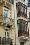 Spanish facade. Two different facades of spanish houses royalty free stock photo