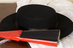 Spanish Fan. Spanish dancers fan, hat and shawl on a wooden case royalty free stock photo