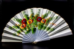 Spanish fan depicting colorful poppies. stock photo