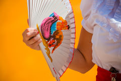 Spanish Fan. Woman's Hand Holding Spanish Fan royalty free stock images