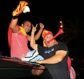 Spanish fans celebrating football world champion. Spanish football fans celebrating the winning of football world cup in the streets Royalty Free Stock Photo