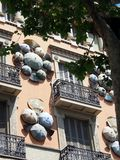 Spanish Fans and Umbrellas on Building, La Rambla, Barcelona Royalty Free Stock Photos