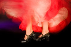 Spanish feet. Detail of the feet and whirling skirt of a flamenco dancer Royalty Free Stock Photos