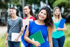 Spanish female student with group of other students stock photo