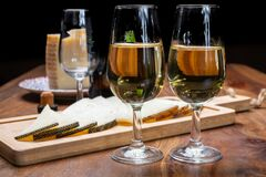 Free Spanish Fino Sherry Wine From Andalusia And Pieces Of Different Sheep Hard Manchego Cheeses Made In La Mancha, Spain. Wine And Royalty Free Stock Photos - 191200638