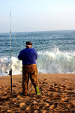 Spanish Fisherman. Lone fisherman prepares his bait on a Spanish beach Stock Images