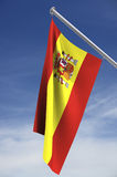 Spanish flag. The Spanish flag against the sky with clipping path vector illustration