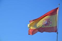 Spanish flag against clear blue sky stock photos