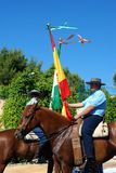 Spanish flag bearers on horses. Stock Photography