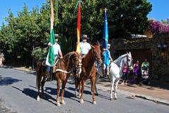 Spanish flag bearers on horses. Royalty Free Stock Photo
