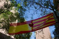Spanish Flag and Catalonian Flag in Barcelona during Protests. Spanish Flag in Residential Neighborhood of Barcelona during Catalonian Independence Stock Photo