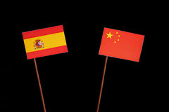 Spanish flag with Chinese flag on black. Background royalty free stock images