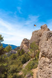The Spanish flag Estelada on the mountain, over blue sky background, Catalunya, Spain. Copy space.  Royalty Free Stock Image