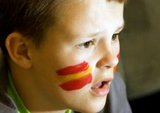 Spanish flag on face of boy Stock Photos