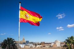 Spanish flag flies over Seville skyline including Cathedral. At lower edge of frame. Bright blue sky provides contrasting background and copy space stock photos