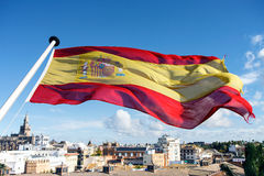 Spanish flag flying over city of Seville Royalty Free Stock Image