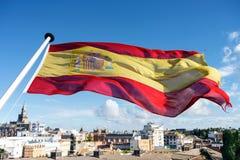 Spanish flag flying over city of Seville Royalty Free Stock Image