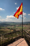 Spanish flag flying over Ronda in Spain. Red and Yellow flag of Spain flying over Ronda in Andalucia on the Costa del Sol Royalty Free Stock Image