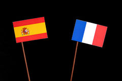Spanish flag with French flag on black stock photography