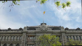 Spanish flag over the library of Madrid stock video