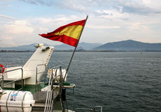 Spanish flag over sea Royalty Free Stock Photography