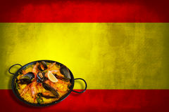 Spanish flag with paella. Traditional spanish dish: paella valenciana on spanish flag Royalty Free Stock Photography